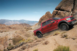 Driving uphill in the dirt with a 2014 Raptor Crew Cab